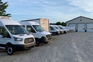 Cargo-vans-and-box-truck-in-lot