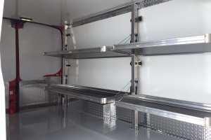 Ford-Transit-148-Mid-Roof-shelving-and-rear-doors